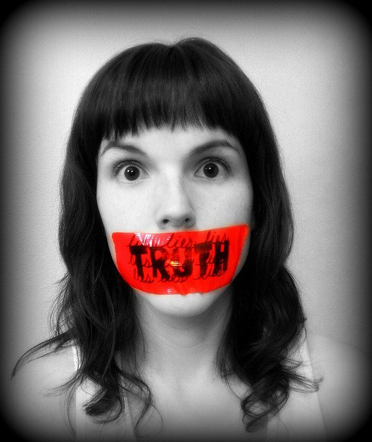 women silenced and gagged