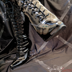 Mistress shiny leather boots
